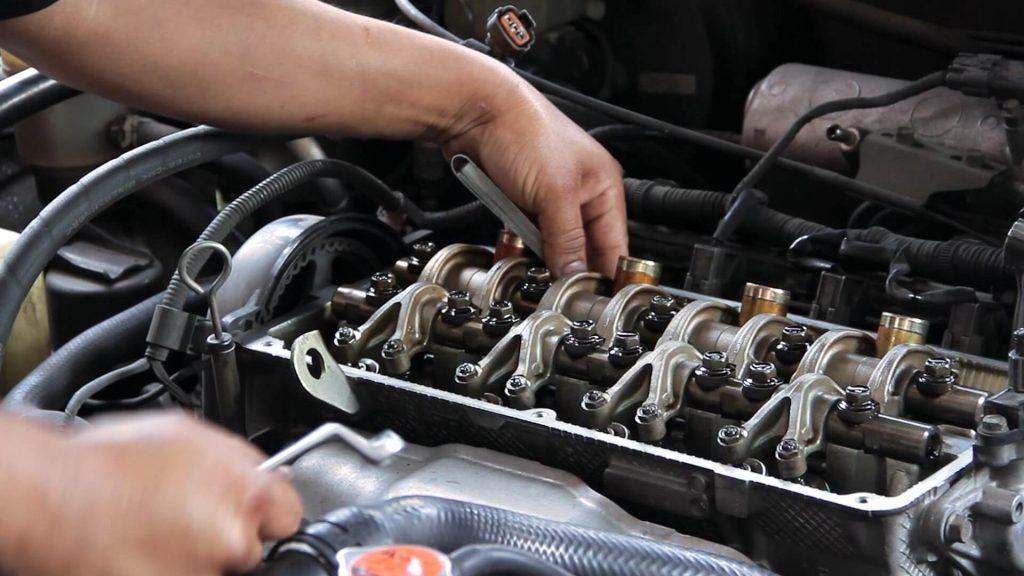 Mechanic checking a car engine